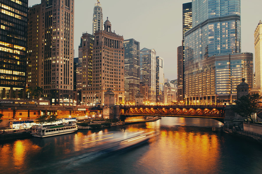 Contact - Blurred View of Bridge and Cityscape at Twilight in Chicago